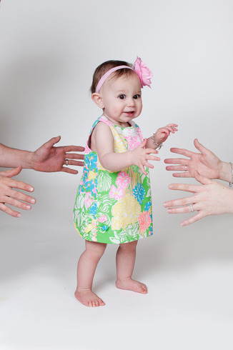 One Year old studio photography walking hands