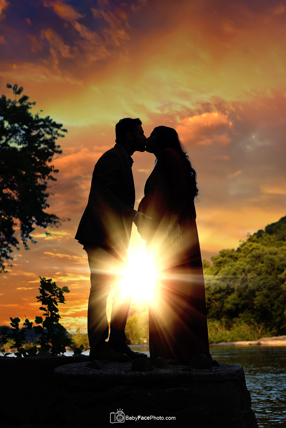 expecting couple in silhouette