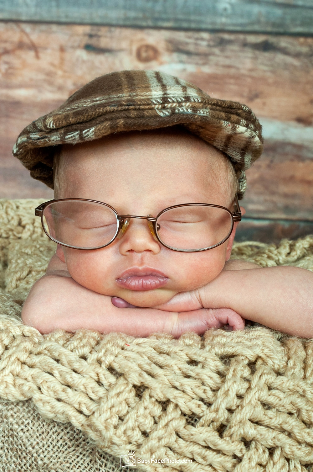 newborn boy wearing glasses and cap