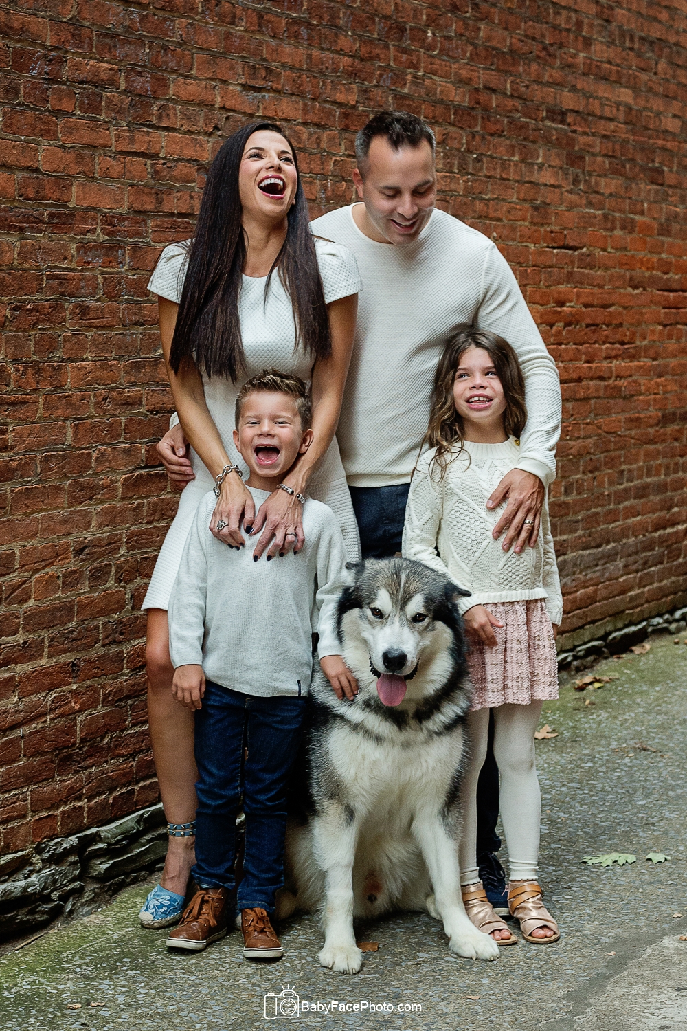 family in alley with dog