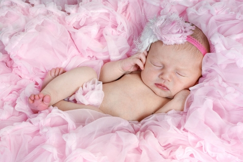 newborn girl in a bunch of tutus