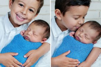 newborn baby boy held by four year old brother