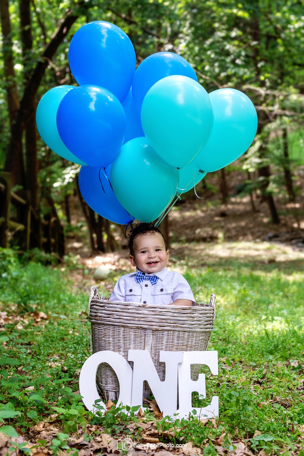one year old baby boy outside in balloon basket